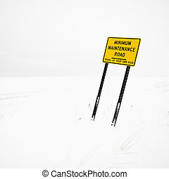 Road sign in blizzard.