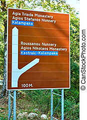 Road sign in Meteora with directions to the monasteries, ...