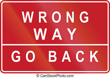 Road sign in the Philippines - Wrong Way, Go Back.