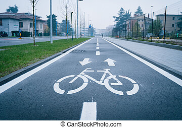 Road sign indicating bike path in the city