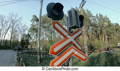 Road sign. Iron level crossing without a barrier.