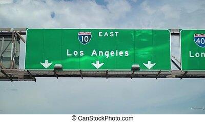 Road sign Los Angeles at highway freeway