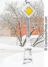 road sign main road under the snow
