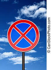 road sign no parking against blue sky and clouds