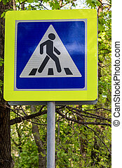 road sign pedestrian crossing in foliage