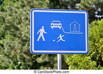 Blue road sign pedestrian zone with blurred background