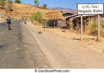 Negade Bahir, Ethiopia - February 6, 2015: Man riding bicycle through Negade Bahir a small village in Ethiopia.