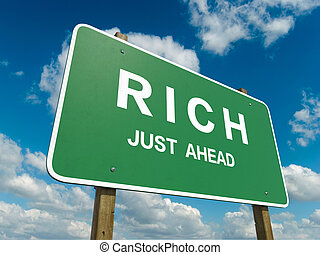Road sign to rich with blue sky