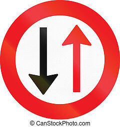Road sign used in Denmark - Give way to oncoming traffic