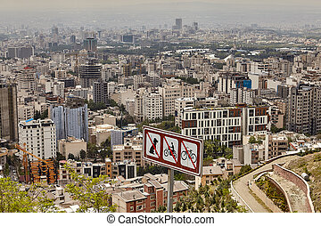 Road sign with crossed dog, motorcycle, and bicycle, Tehran, Iran.