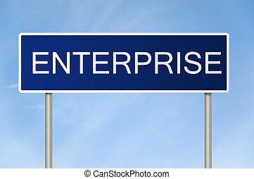 Road sign with text Enterprise - A blue road sign with white...