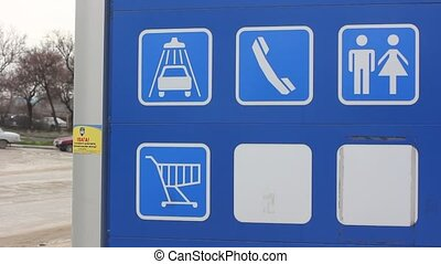 road signs on gas station board