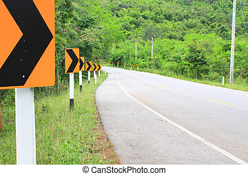 Road Signs warn Drivers for Ahead Dangerous Curve