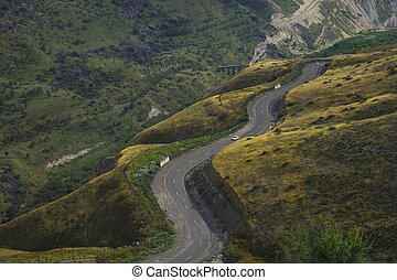 Road snaking through mountain landscape