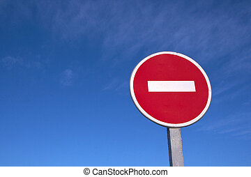 Road stop sign against clear deep blue sky