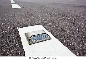 An Old Cats Eye Road Reflector