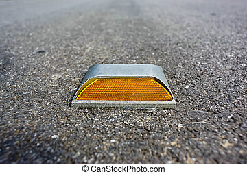 road stud with yellow reflector