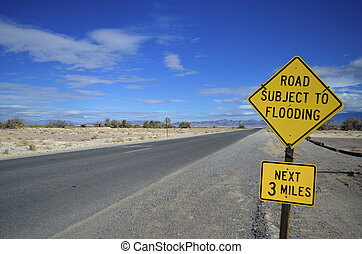 Road Subject to Flooding Sign