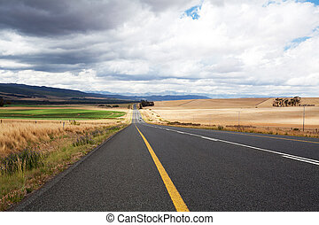 road through farm land in south africa