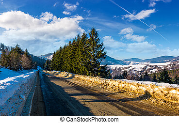 road through forest in winter. beautiful nature scenery with...