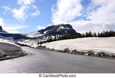 Road through Logan pass - Scenic road through Logan pass in...