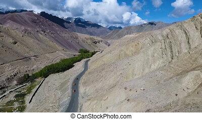 Road Through Mountainous Desert - Drone, exterior, pushing...