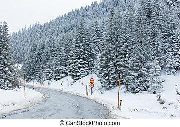 Road through snowy mountains