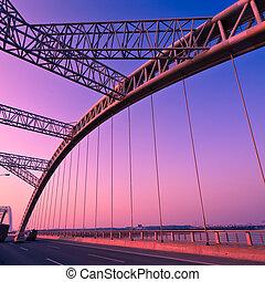 bridge - road through the bridge with blue sky background of...