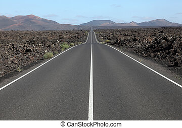 Road through the lava fields on Lanzarote, Spain