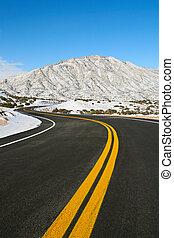 road through winter mountains