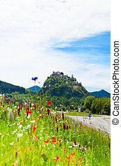 Hochosterwitz castle in Austria among poppy flowers