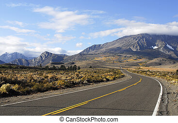 Road to Mountains - road in high desert leading to fall...