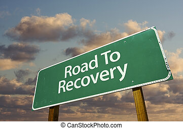 Road To Recovery Green Road Sign with dramatic clouds and...