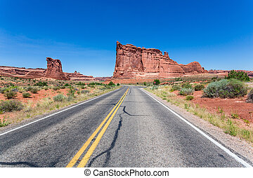 Road to sandstone with skyline