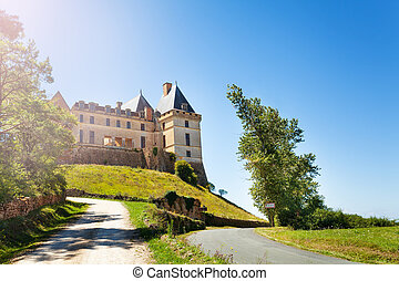 Road to the Chateau de Biron castle in France