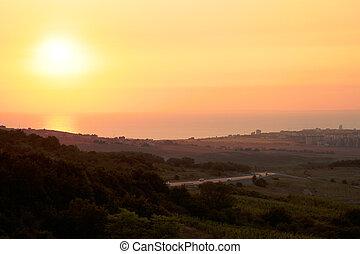 road to the coastal city at sunset