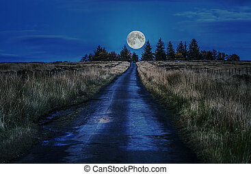 Road to the Moon - Counrty Road leading to the Moon in...