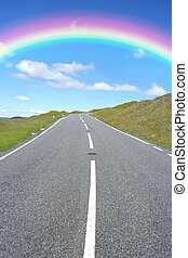 Road to the Rainbow - Uphill rural road with a rainbow and...