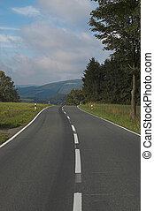 Road towards destiny - Road towards the green summer hills...