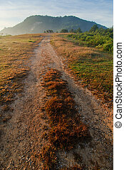 Road track to mountain at sunrise