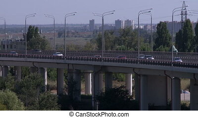 Road traffic. View of cars moving on bridge
