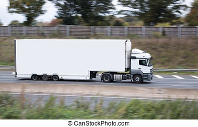 Road transport - lorry in motion on the motorway