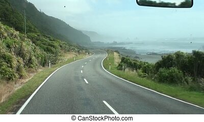 Road trip in the green mountains of New Zealand.
