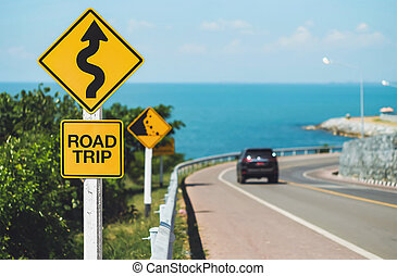 road trip word and curvy road sign
