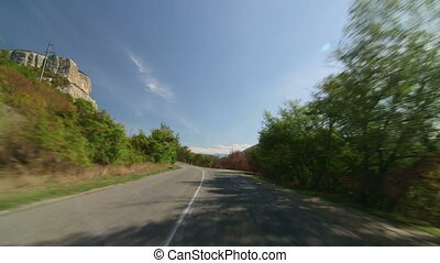 Road trip through the valley between rocks to Crimean...