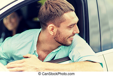 happy smiling man driving in car