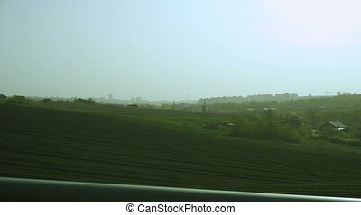 road view of green fields and hills