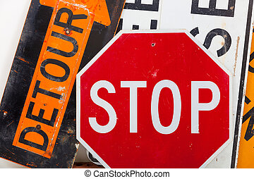 Road warnings signs as a background - Detour sign, stop sign...