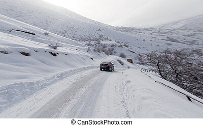 road with a car in winter in the mountains
