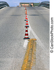 road with a steep climb without cars with traffic cones